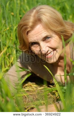 Nice old woman is enjoying the fresh air