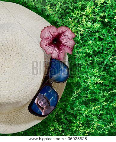Closeup hat, flower and sunglasses
