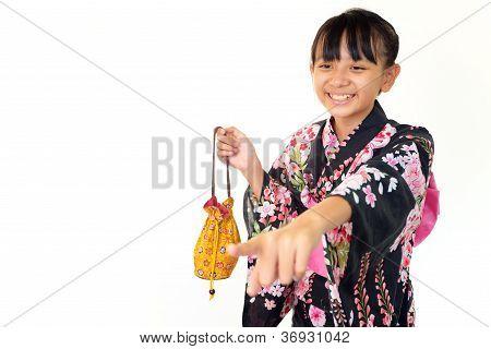 Smiling japanese girl wearing yukata