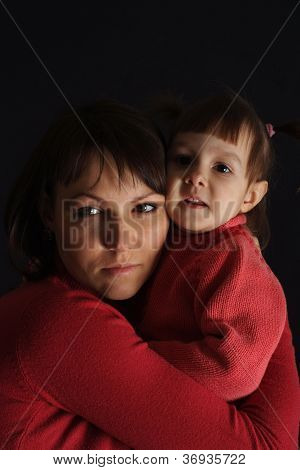 Beautiful sad Caucasian mother with a daughter