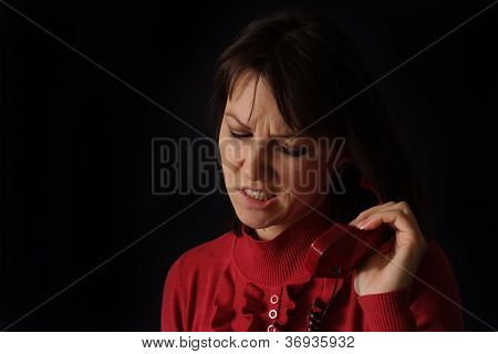 Pretty sad Caucasian woman talking on the phone