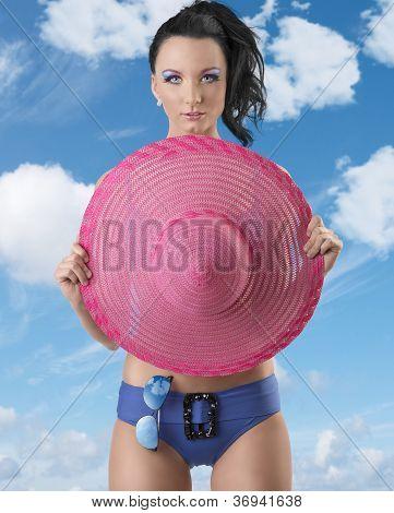 Pretty Brunette In Bikini With Pink Hat