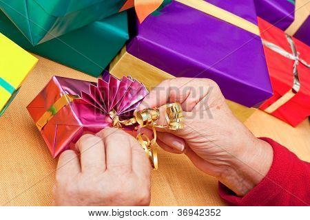 Senior Citizen Wrap Or Unpack Presents, Closeup