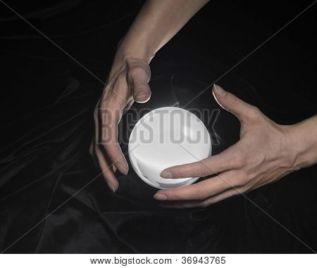 Crystal Ball And Hands Around