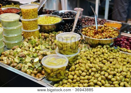 Olives, Pickles And Salads On Market Stand