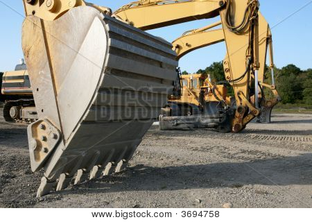 Construction Lineup With Close Backhoe