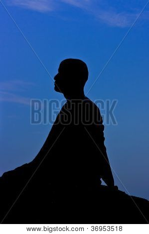 Silhouette Of Monk Meditating