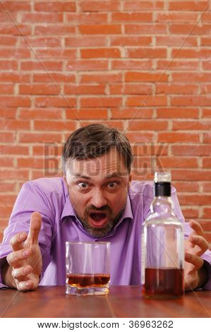 angry man getting drunk