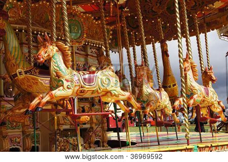 Vintage carousel with jumping horses