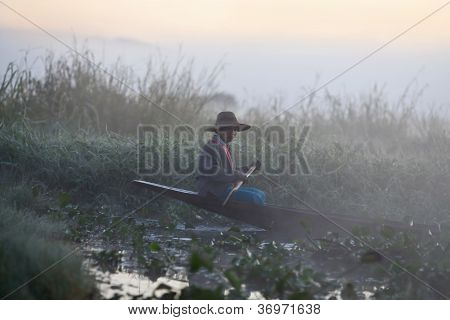 Pa-o Tribe Woman Floating In Wooden Boat, Myanmar