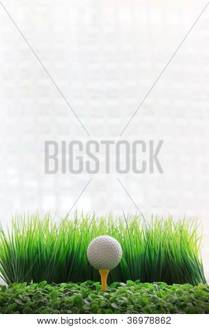 golf ball on yellow tee and blue sky background