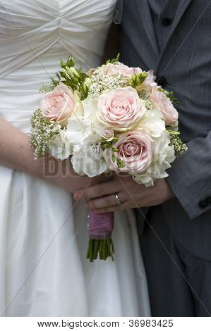 Bride And Groom Hold Wedding Bouquet