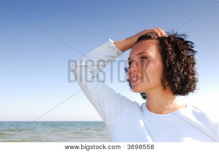 Woman On The Beach Looking Away