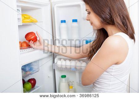 Woman searching in her fridge