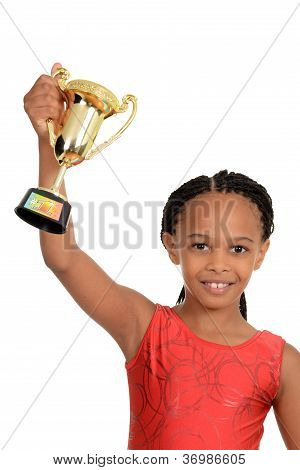 Young black child with gymnastics trophy