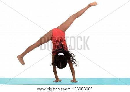 Young black girl doing gymnastics cartwheel motion blur