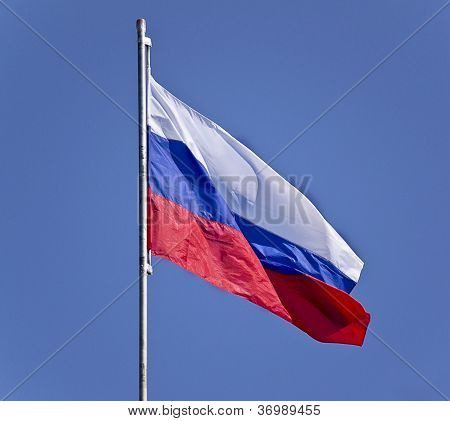 Russian Flag On A Background Blue Sky