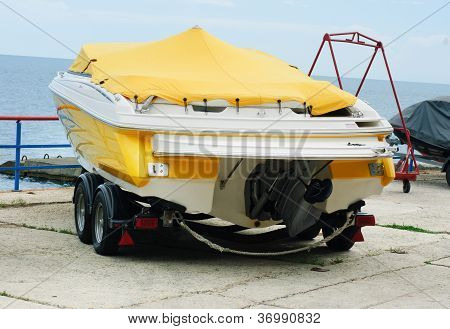 Boat On A Trailer  On The  Sea And  Sky  Background