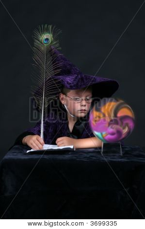 Wizard Child Looking Into Colorful Swirled Crystal Ball