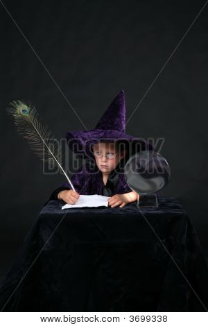 Wizard Child With Peacock Feather Pen And Crystal Ball