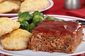 picture of meatloaf  - Closeup of slice of meatloaf with biscuits and brussels sprouts - JPG