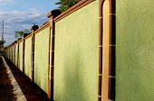 stock photo of subdivision  - High concrete wall structure in an exclusive subdivision - JPG