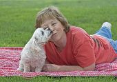 picture of maltipoo  - Adult Woman Getting A Kiss From Her Dog - JPG