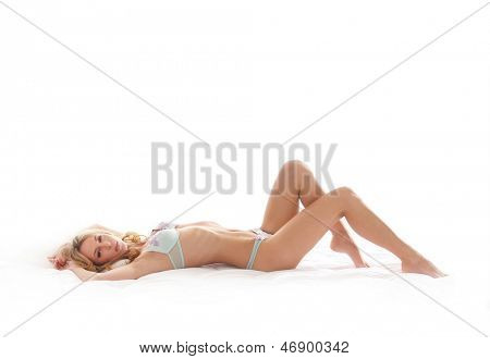 Young sexy girl in erotic lingerie over white