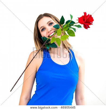 young woman holding red rose in her mouth