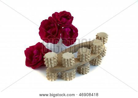 Wooden  Massager  And Bouquet Of Red Roses