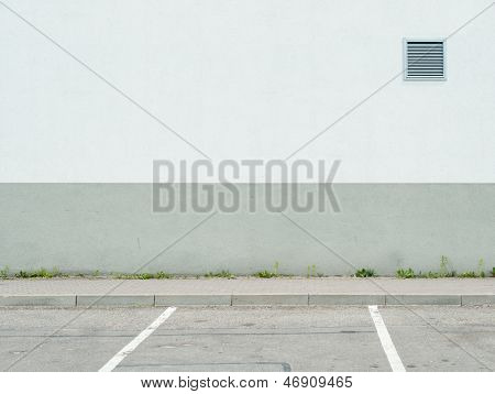 Parking lot wall and sidewalk