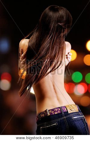 Woman With Long Brown Hair Over Bright Night Lights