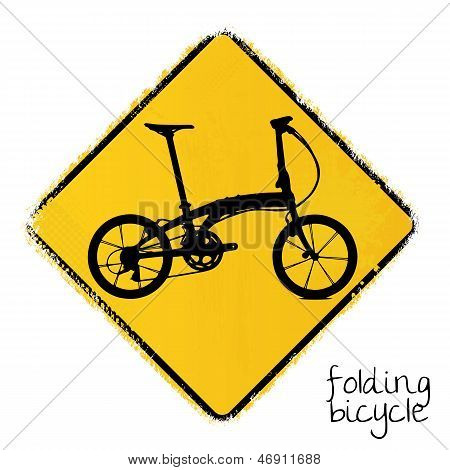 warning road sign with a folding bicycle