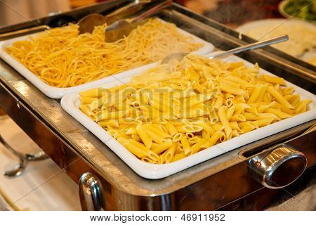Hot Pasta In Serving Dishes