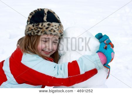 Happy With Her Snowman