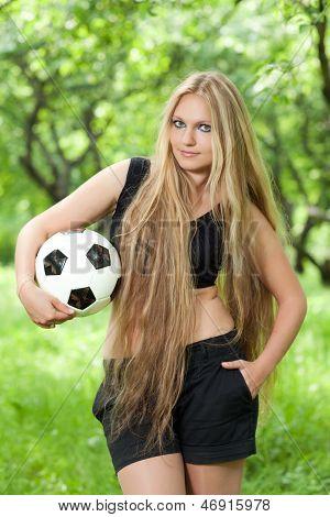 Woman Holding A Soccer Ball