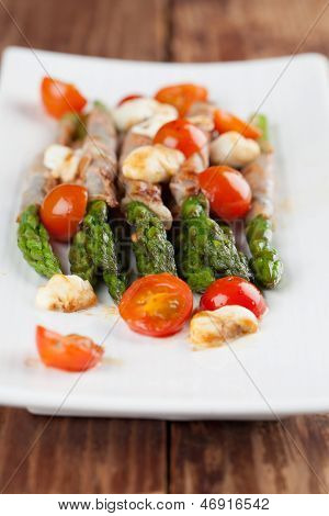 Grilled Asparagus With Prosciutto, Moyyarella And Cherrz Tomatoes