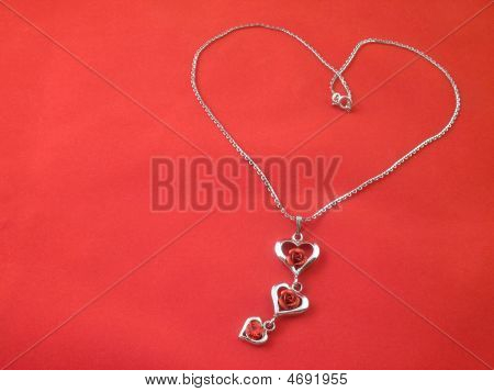Silver Chain Lying In The Form Of Heart