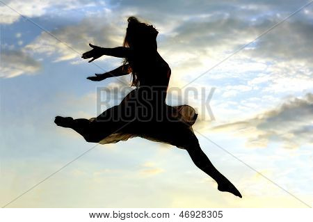 Woman Leaping Through The Sky