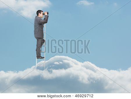 Businessman standing on ladder over the clouds and looking at the horizon with binoculars
