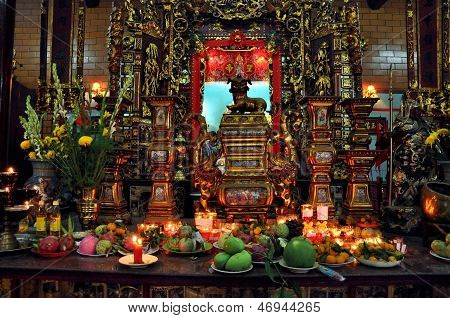 Offerings in a Buddhist temple, Vietnam