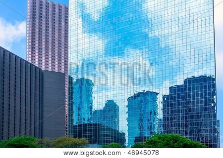 Houston downtown skyscrapers disctrict with mirror blue sky reflection
