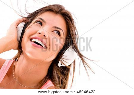 Woman listening to music with headphones - isolated over white