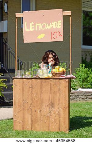 bored girl at lemonade stand