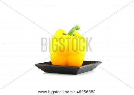 Yellow Sweet Pepper In The Black Bamboo Dish.