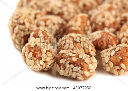 Tasty peanuts with sesame and caramel, isolated on white