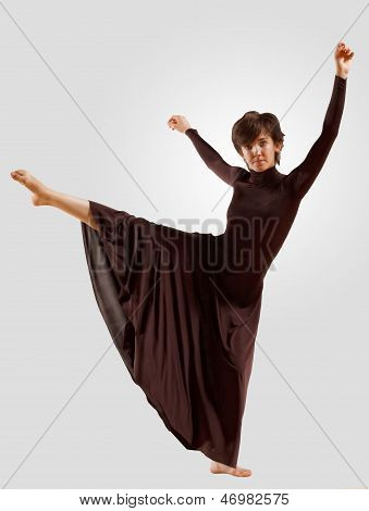 Girl in dark dress dancing