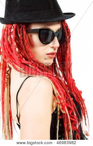 Portrait of expressive girl with great red dreadlocks. Isolated over white.