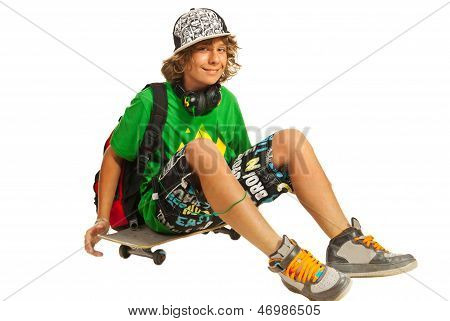 Happy Teen Sitting On Skateboard