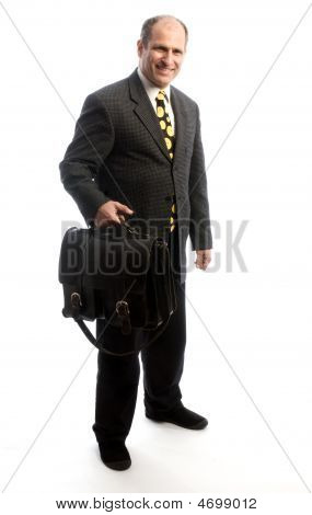 Senior Corporate Executive Traveling With Leather Bag